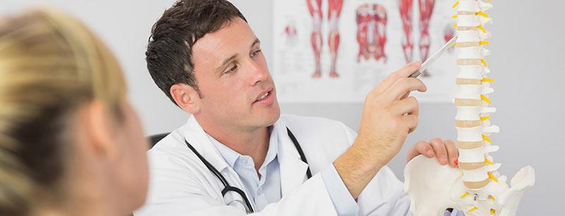 Chiropractor-walking-patient-through-popular-chiropractic-techniques
